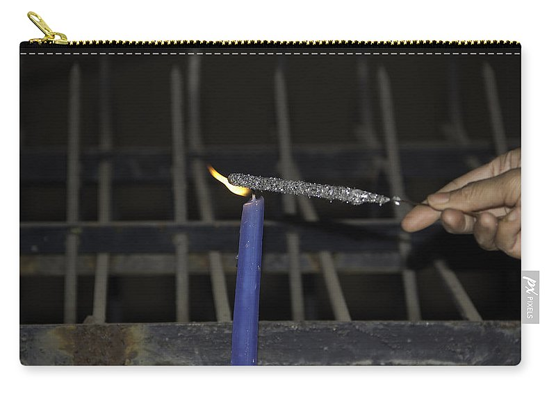 Action Carry-all Pouch featuring the photograph Lighting A Sparkler With A Candle As A Part Of Diwali Celebrations by Ashish Agarwal