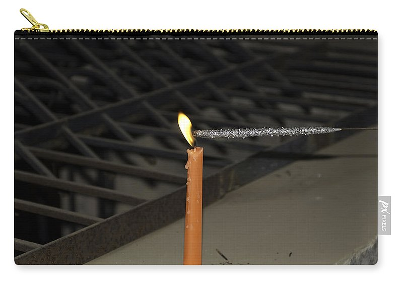 Candle Carry-all Pouch featuring the photograph Lighting A Sparkler With An Orange Candle by Ashish Agarwal