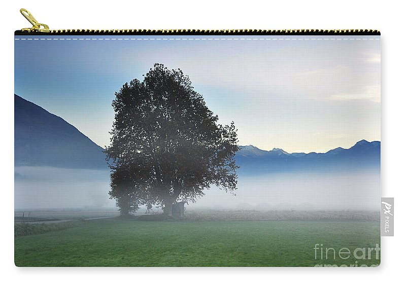 Tree Carry-all Pouch featuring the photograph Lonely Tree In The Fog by Mats Silvan