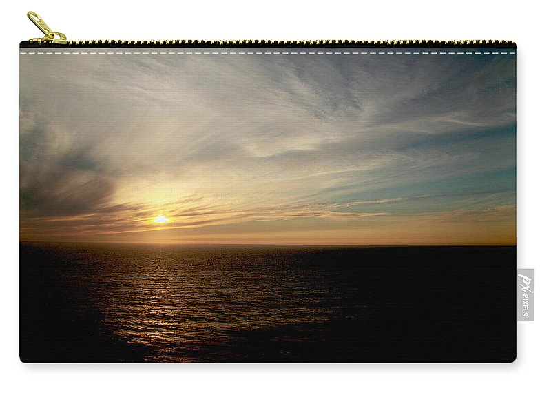 Low Carry-all Pouch featuring the photograph Low Sun Over The Pacific by Mick Anderson