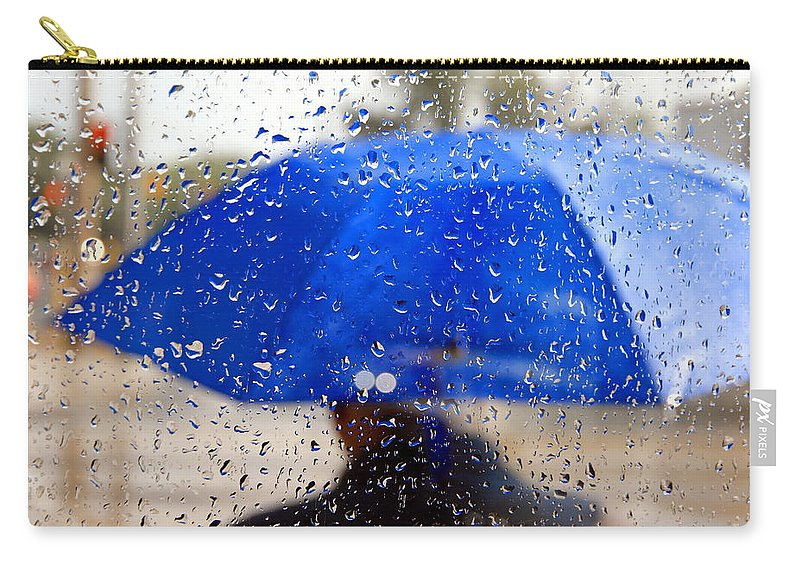 Umbrella Carry-all Pouch featuring the photograph Man With Blue Umbrella by Valentino Visentini