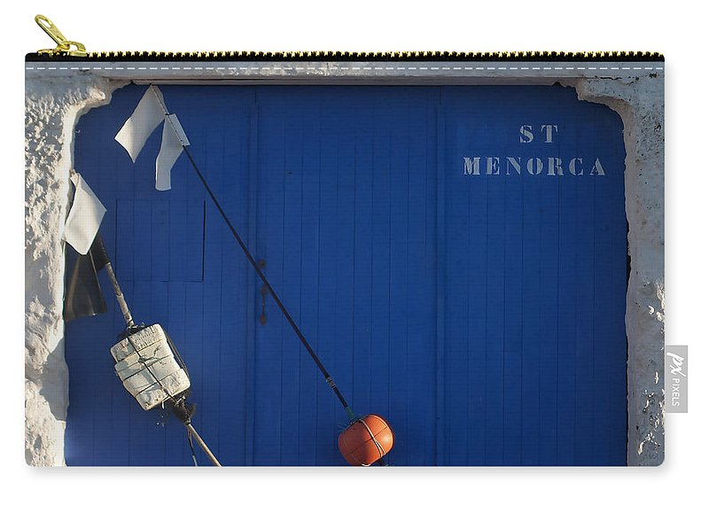 Orange Carry-all Pouch featuring the photograph menorca st - A warehouse door in Es Castell Menorca ready to keep local tradicional boats llauts by Pedro Cardona Llambias