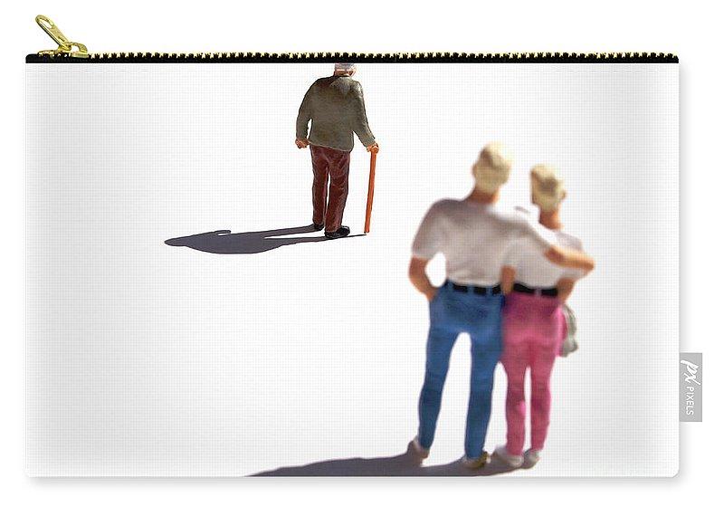 Watching Carry-all Pouch featuring the photograph Miniature Figurines Couple Watching Elderly Man by Bernard Jaubert