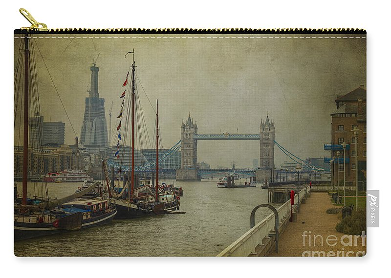 Thames Carry-all Pouch featuring the photograph Moored Thames Barges. by Clare Bambers