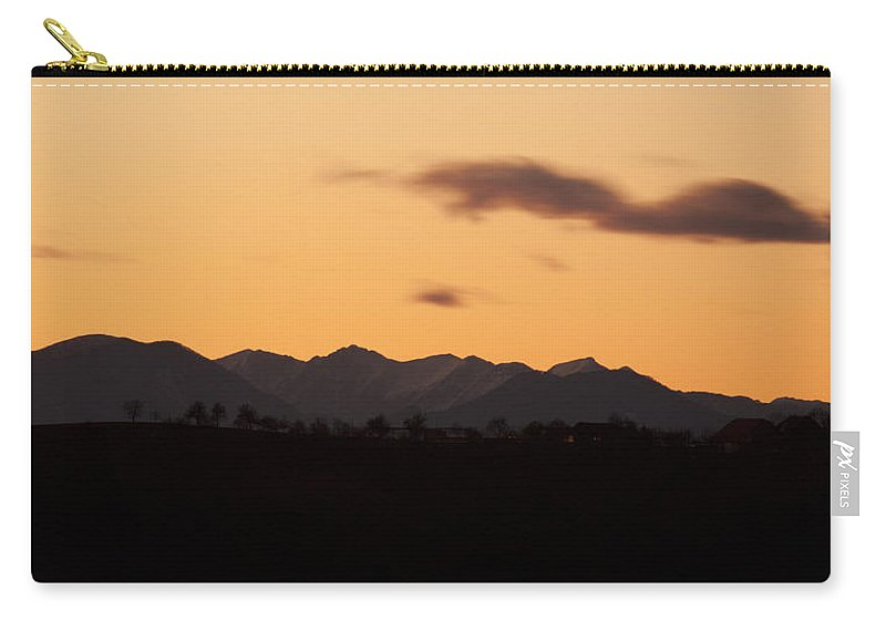Mountains Carry-all Pouch featuring the photograph Mountain Sunset by Ian Middleton