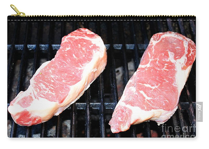 Raw Carry-all Pouch featuring the photograph New York Steak by Henrik Lehnerer