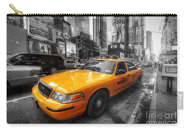 Art Carry-all Pouch featuring the photograph Nyc Yellow Cab by Yhun Suarez