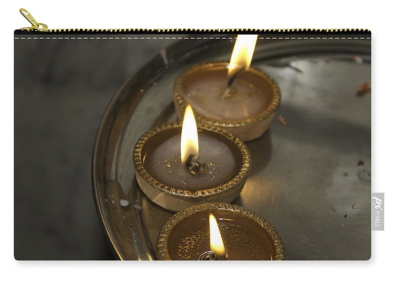 Celebrating Carry-all Pouch featuring the photograph Oil Lamps Kept In A Plate As Part Of Diwali Celebrations by Ashish Agarwal