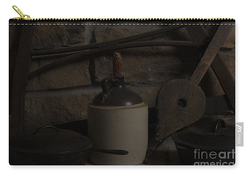 Antique Carry-all Pouch featuring the photograph Old Items On A Stone Hearth 2 by Alan Look