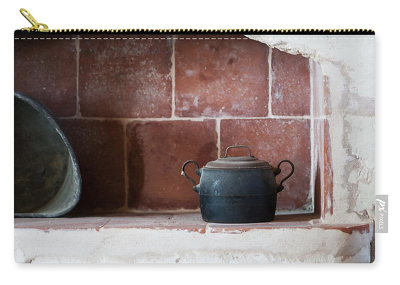 Scene Carry-all Pouch featuring the photograph old kitchen - A part of a traditional kitchen with a vintage metal pot by Pedro Cardona Llambias
