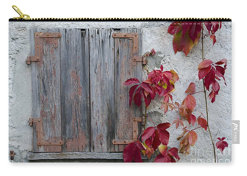 Old Carry-all Pouch featuring the photograph Old Window With Red Leaves by Mats Silvan