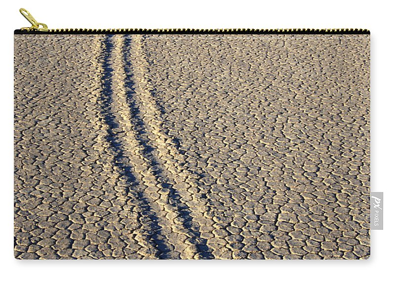 The Racetrack Carry-all Pouch featuring the photograph On The Move by Bob Christopher