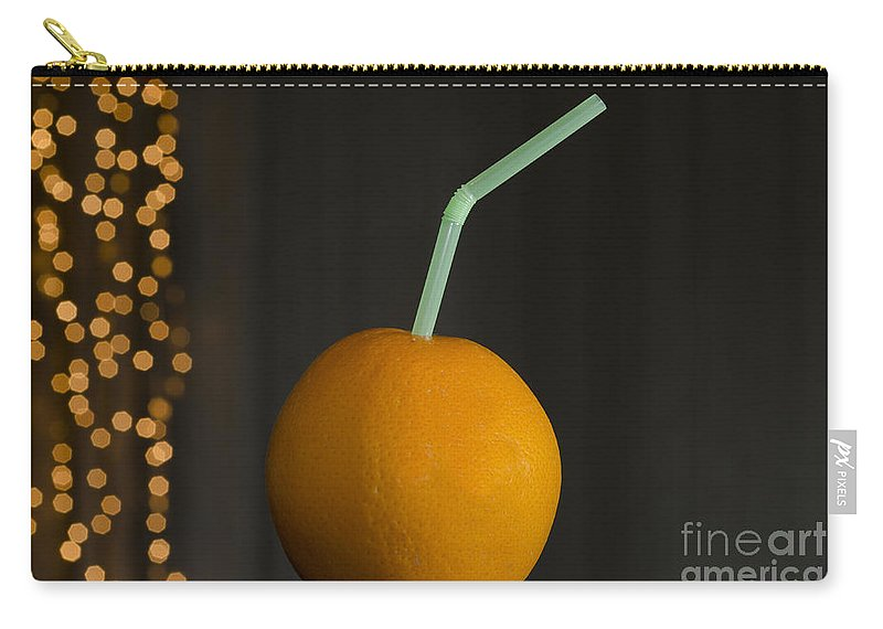 Orange Carry-all Pouch featuring the photograph Orange With Straw by Mats Silvan