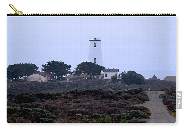 Lighthouse Carry-all Pouch featuring the photograph Peidras Blancas Lighthouse by Eric Tressler