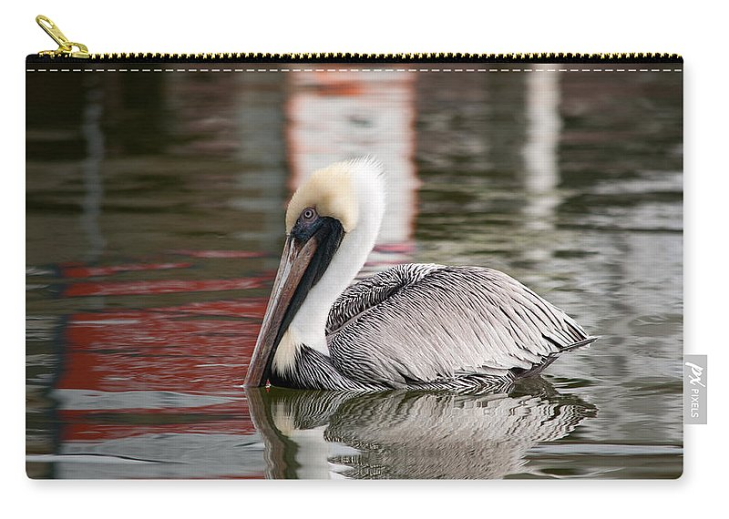 Pelican Carry-all Pouch featuring the photograph Pelican With Red Reflections by Christine Stonebridge