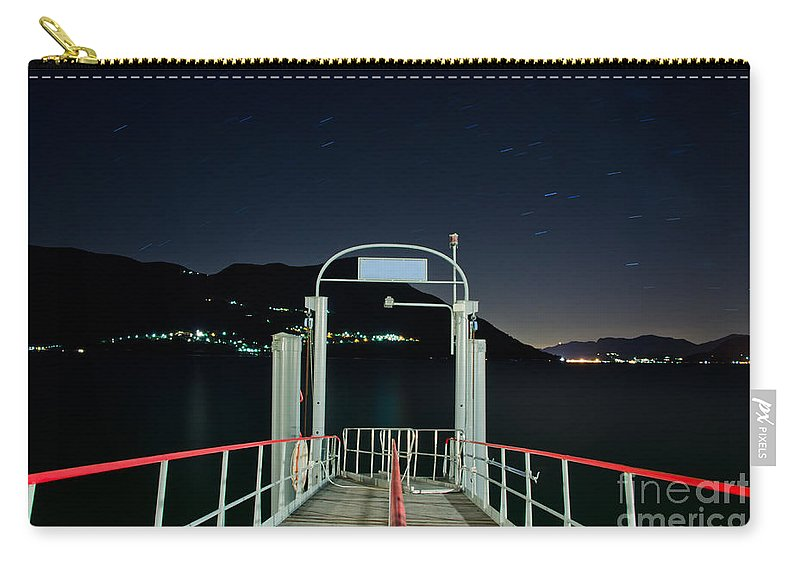 Pier Carry-all Pouch featuring the photograph Pier At Night by Mats Silvan