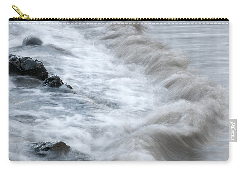 Outdoor Carry-all Pouch featuring the photograph playing with waves 3 - Mediterranean sea foam playing with black stones in cala mesquida - menorca by Pedro Cardona Llambias