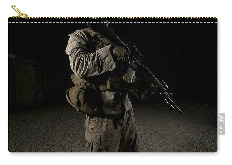 Operation Enduring Freedom Carry-all Pouch featuring the photograph Portrait Of A U.s. Marine by Terry Moore