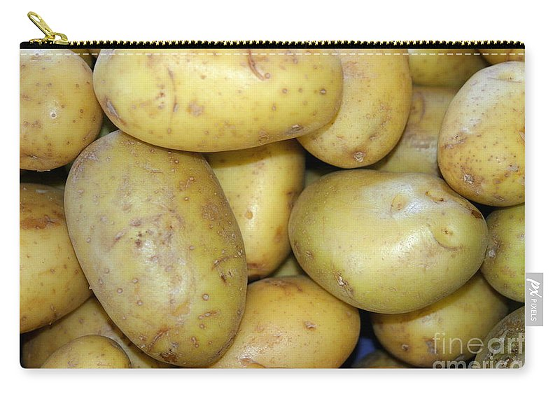 Agriculture Carry-all Pouch featuring the photograph Potatoes by Henrik Lehnerer