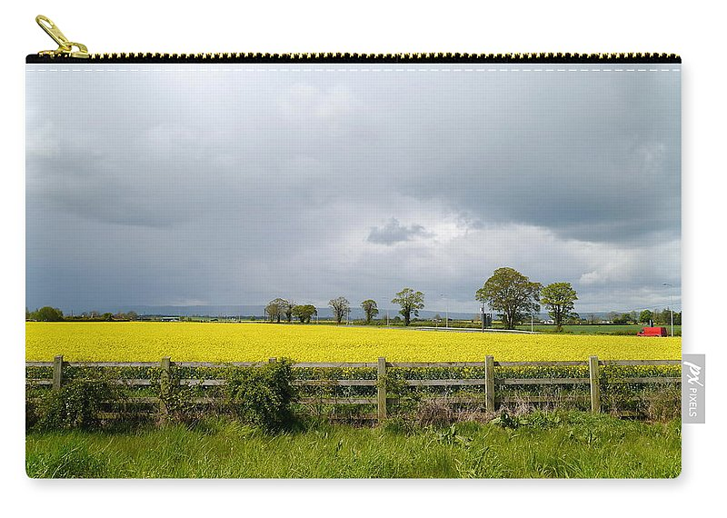 Canola Field Carry-all Pouch featuring the photograph Rain Clouds Over Canola Field by Christiane Schulze Art And Photography