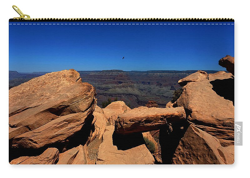 Ooh Aah Point Carry-all Pouch featuring the photograph Raven Flying Near Ooh Aah Point by Julie Niemela