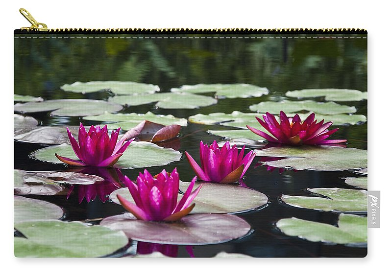 Red Water Lillies Carry-all Pouch featuring the photograph Red Water Lillies by Bill Cannon