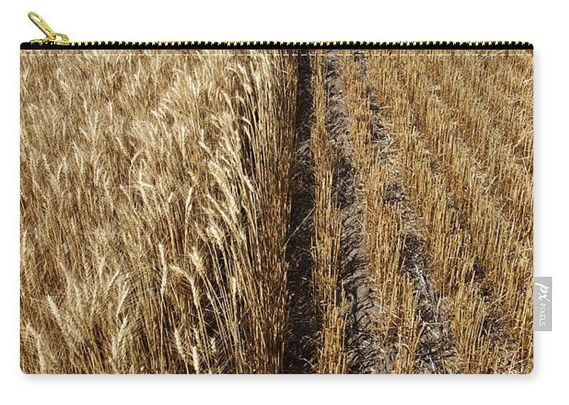 Carry-all Pouch featuring the photograph Ripened Wheat And Stubble In Saskatchewan Field by Mark Duffy