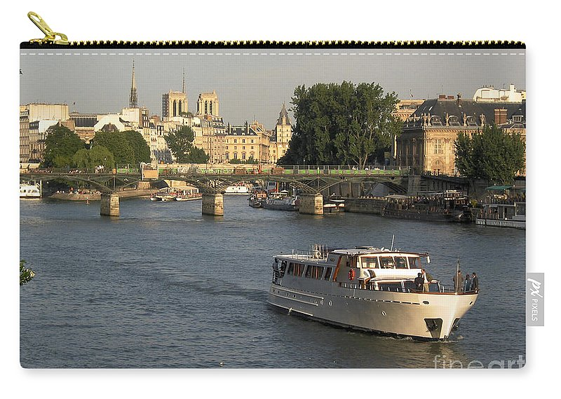 Aged Carry-all Pouch featuring the photograph River Seine In Paris by Bernard Jaubert