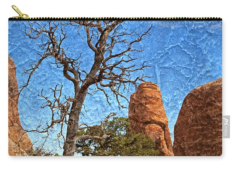 Dead Tree Carry-all Pouch featuring the photograph Rock Garden Skeleton Arches National Park by John Stephens