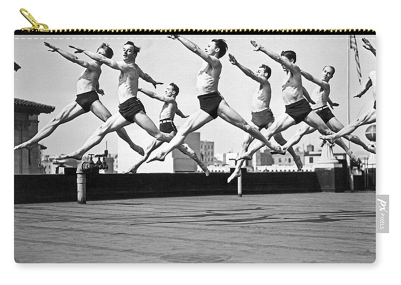 B And W Carry-all Pouch featuring the photograph Rooftop Dancers In New York by Underwood Archives