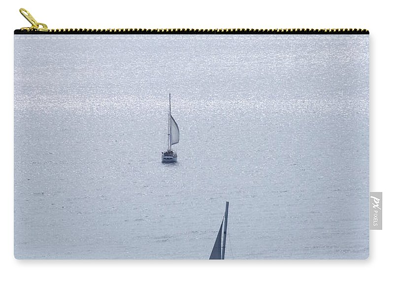 Mary Deal Carry-all Pouch featuring the photograph Sailing In The Glow by Mary Deal