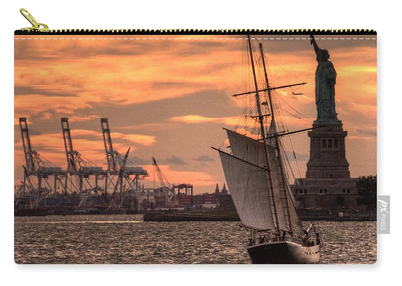 Statue Carry-all Pouch featuring the photograph Sailing To Liberty by Rob Hawkins