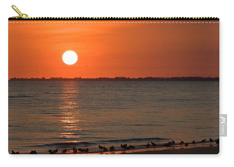 Beach Carry-all Pouch featuring the photograph Sandpipers At Sundown by Ed Gleichman