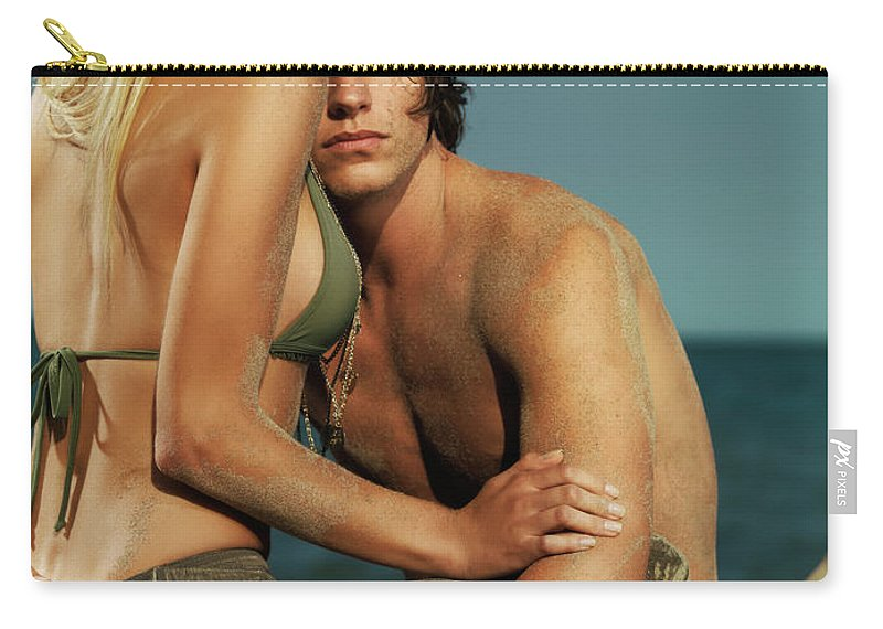 Couple Carry-all Pouch featuring the photograph Sensual Portrait Of A Young Couple On The Beach by Oleksiy Maksymenko