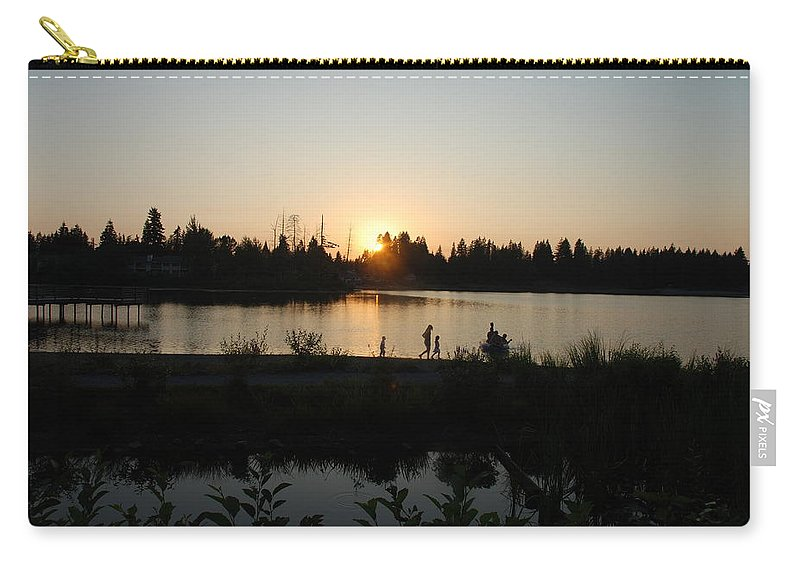 Summer Carry-all Pouch featuring the photograph Setting Sun by Michael Merry
