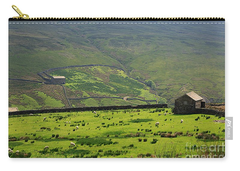 Field Carry-all Pouch featuring the photograph Sheep Graze In A Pasture In Swaledale by Louise Heusinkveld