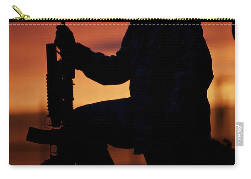 Sandbag Carry-all Pouch featuring the photograph Silhouette Of A U.s Marine On A Bunker by Terry Moore
