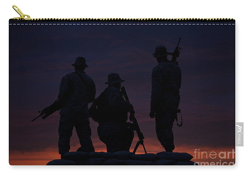 Marine Carry-all Pouch featuring the photograph Silhouette Of U.s Marines On A Bunker by Terry Moore