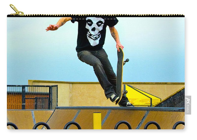 Skateboarding Carry-all Pouch featuring the photograph Skateboarding Xi by Sheila Laurens