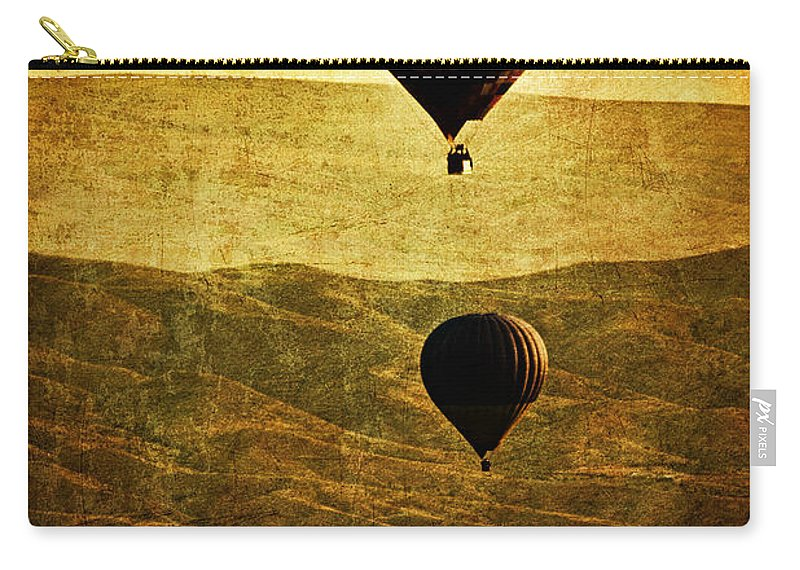 Hot Carry-all Pouch featuring the photograph Soaring Heights by Andrew Paranavitana