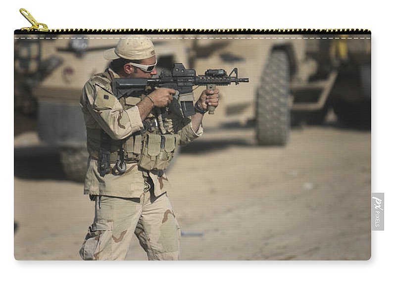 Kunduz Carry-all Pouch featuring the photograph Soldier Fires A M4 Carbine by Terry Moore