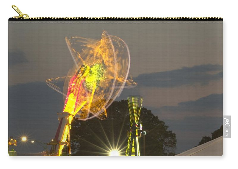 Ride Carry-all Pouch featuring the photograph Spinning by Donna Brown