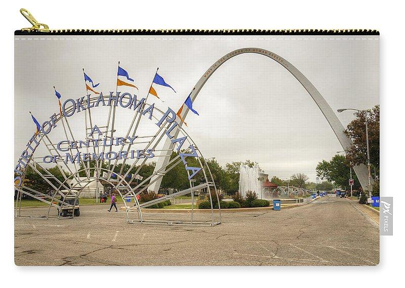 Fair Carry-all Pouch featuring the photograph Spirit Of Oklahoma Plaza by Ricky Barnard