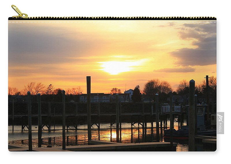 Sunset Carry-all Pouch featuring the photograph Spreading Sun by Catie Canetti
