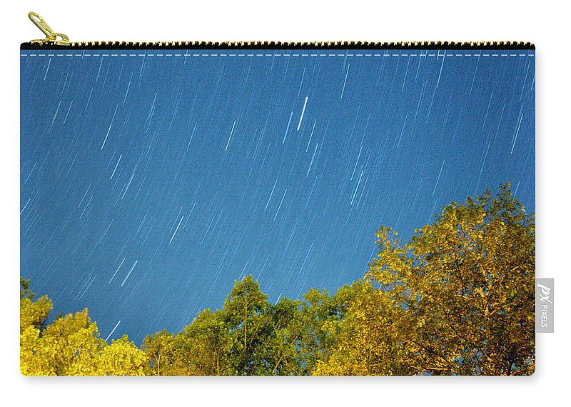 Night Carry-all Pouch featuring the photograph Star Trails On A Blue Sky by Kay Lovingood