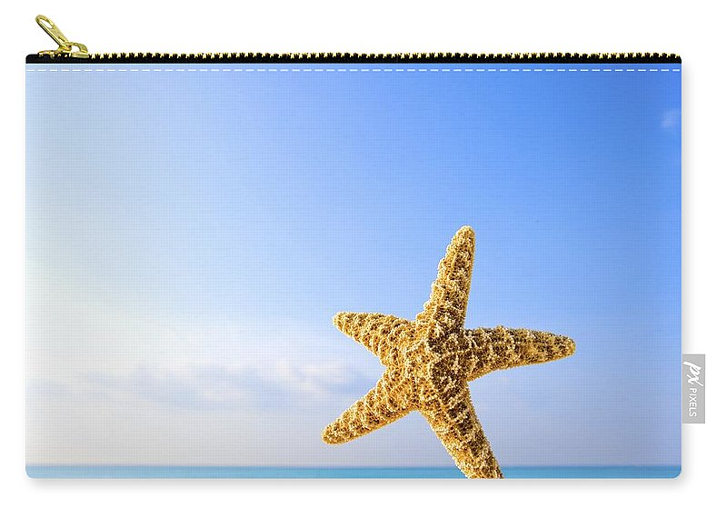 Animals Carry-all Pouch featuring the photograph Starfish In Front Of The Ocean by Richard Wear