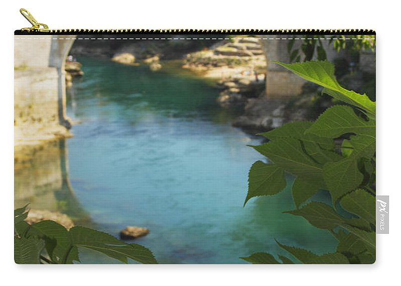 Blue Sky Carry-all Pouch featuring the photograph Stari Most Or Old Town Bridge Over The by Trish Punch