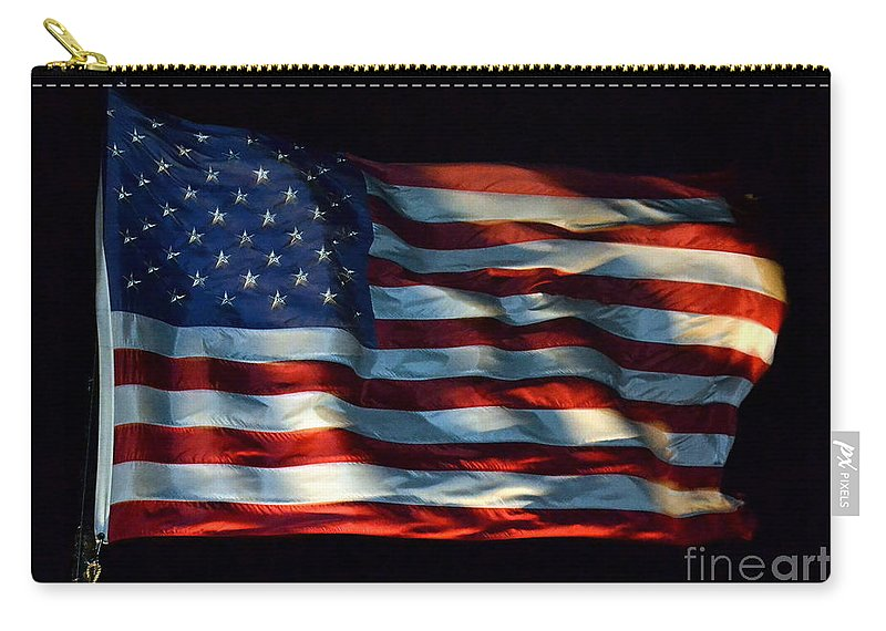 Flag Carry-all Pouch featuring the photograph Stars And Stripes At Night by Kevin Fortier