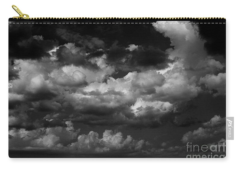 Black And White Carry-all Pouch featuring the photograph Storm Clouds 1 by Ashley M Conger