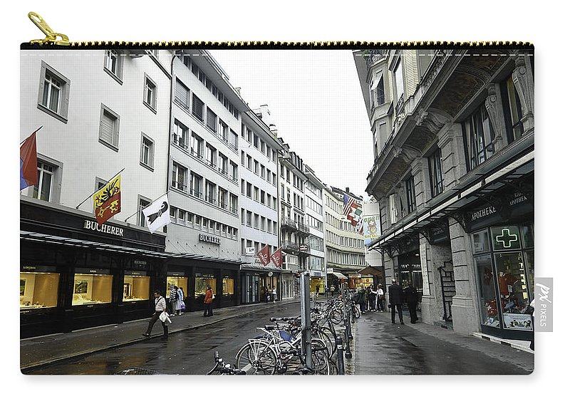 Action Carry-all Pouch featuring the photograph Street In Lucerne With Cycles And Rain by Ashish Agarwal